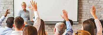 classroom people raising hands